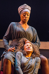 © Licensed to London News Pictures. 21/10/2013. Theatre Royal Stratford East presents Crowning Glory, a new play by Somalia Seaton that seeks to reveal a hidden world of unobtainable beauty by asking the question, how do women truly see themselves in today's world? Picture features (Back) T'Nia Miller (Bal-Ead) & Allyson Ava-Brown (Halfbreed). Photo credit: Tony Nandi/LNP.