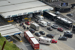 © Licensed to London News Pictures. 23/07/2016. Dover, UK.  Cars and trucks queue up at border control in the port of Dover. Long delays are currently being experienced after increased security checks were put in place. Photo credit: Peter Macdiarmid/LNP