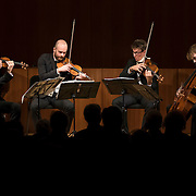 "February 22, 2015 - New York, NY : From left, The Calder Quartet's Ben Jacobson (violin), Andrew Bulbrook (violin), Jonathan Moerschel (viola), and Eric Byers (cello) perform at the Brooklyn Public Library, Central Library as part of Carnegie Hall's ""Neighborhood Concert"" series on Sunday afternoon. CREDIT: Karsten Moran for The New York Times"