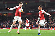 Arsenal Midfielder Aaron Ramsey (8) and Arsenal Forward Pierre-Emerick Aubameyang (14) control the ball during the Europa League group stage match between Arsenal and Sporting Lisbon at the Emirates Stadium, London, England on 8 November 2018.