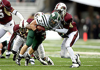 Ohio running back Beau Blankenship (22) is brought down by Louisiana-Monroe safety Cordero Smith (10) during the third quarter of the Independence Bowl NCAA college football game in Shreveport, La., Friday, Dec. 28, 2012. Blankenship ran for four scores, and Ohio cruised to a 45-14 victory.