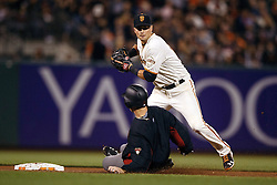 SAN FRANCISCO, CA - APRIL 20: Zack Greinke #21 of the Arizona Diamondbacks slides into second base to break up a double play attempt by Joe Panik #12 of the San Francisco Giants during the sixth inning at AT&T Park on April 20, 2016 in San Francisco, California.  (Photo by Jason O. Watson/Getty Images) *** Local Caption *** Zack Greinke; Joe Panik
