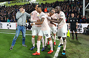 GOAL - Manchester United Midfielder Ashley Young celebrates with Manchester United Defender Luke Shaw with fan on the pitch during the Premier League match between Crystal Palace and Manchester United at Selhurst Park, London, England on 27 February 2019.