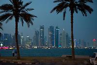 """10 APR 2013, DOHA/QATAR<br /> Doha Downtown mit Hochhaeusern (zwischen den palem). Palm Towers,Al Bidda Tower , Qatar World Trade Center und Doha Tower, auch """"Condom Tower"""", gesehen von der Al Corniche Street<br /> IMAGE: 20130410-01-082<br /> KEYWORDS: Katar, Hochaus, Wolkenkratzer, Tower, Skyscraper, Nacht, Nachtaufnahme, Abend, Abendaufnahme, nachts, abends, night, Hochhaeuser, Hochäuser, Skyscraper, West Bay"""