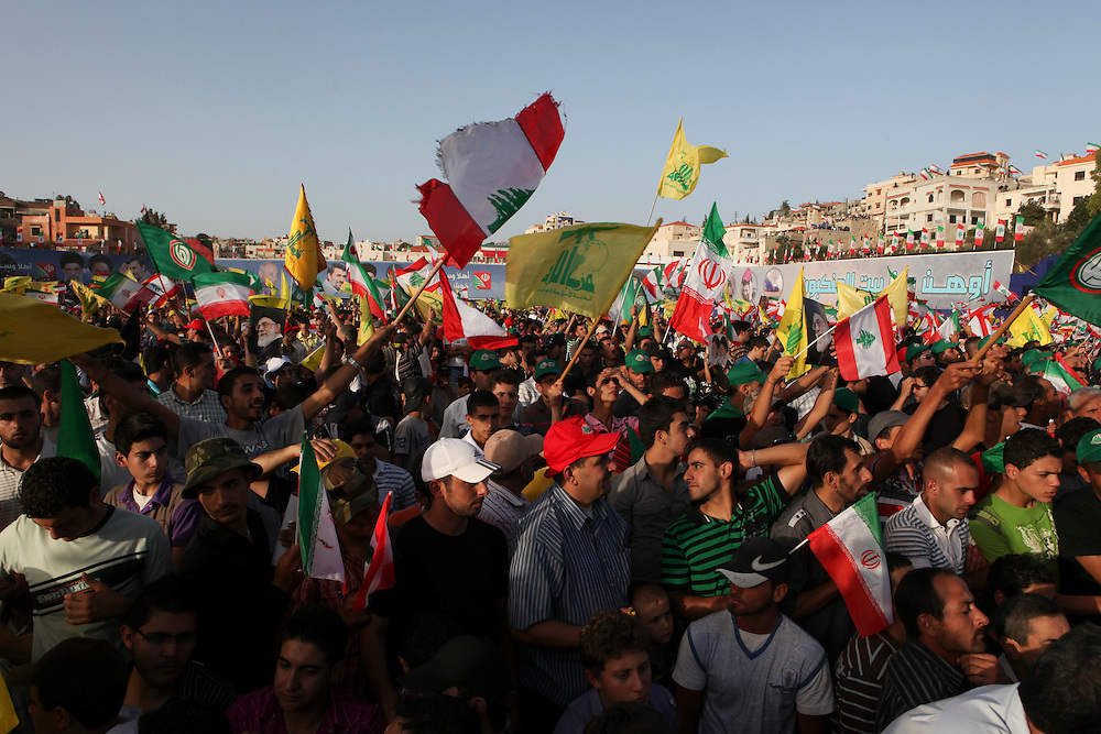 On the second and final day of his visit to Lebanon, Iranian President Mahmoud Ahmadinejad traveled to the southern town of Bint Jbeil. There a Hizballah-organized rally was held to welcome Ahmadinejad to the south Lebanon, an area where Hizballah is widely supported. Tens of thousands gathered for hours holding flags of Iran, Hizballah, Lebanon and other political parties, cheering the Iranian president as he arrived by helicopter from Beirut. ///People rally at a stadium in Bint Jbeil waiting for Iranian President Mahmoud Ahmadinejad to address the crowd..