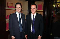 Left to right, GEORGE OSBORNE MP and DAVID CAMERON MP leader of the Conservative party  at a party to celebrate the 10th anniversary of the Smythson Fashion Diary and to the launch of the 2007 Limited Edition held at Smythson, New Bond Street, London on 25th October 2006.<br />