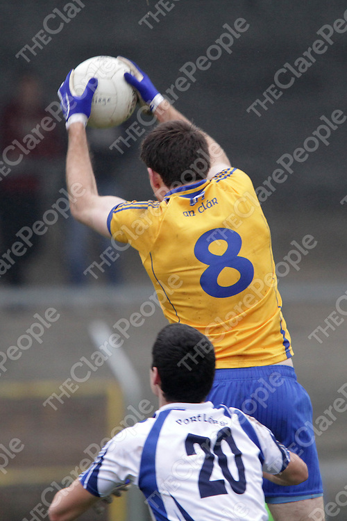 Clare's Gary Brennan wins his aerial battle for possession with Waterford's Shane Ahearne in their Division 4 clash @ Cusack Park. - Photograph by Flann Howard
