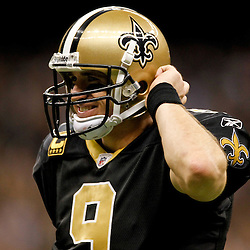 January 1, 2012; New Orleans, LA, USA; New Orleans Saints quarterback Drew Brees (9) reacts after throwing a touchdown against the Carolina Panthers during the second half of a game at the Mercedes-Benz Superdome. The Saints defeated the Panthers 45-17. Mandatory Credit: Derick E. Hingle-US PRESSWIRE