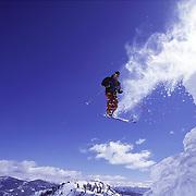 A man jumping while skiing at