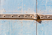 Blue Weathered wooden background and hinges