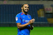 Ellis Harrison (22) of Portsmouth applauds the fans after the the team won the penalty shoot out at full time during the Leasing.com EFL Trophy match between Oxford United and Portsmouth at the Kassam Stadium, Oxford, England on 8 October 2019.