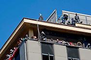 Roma 16 Aprile 2014<br /> Sgomberato palazzo in  via Baldassarre Castiglione alla Montagnola occupato nei giorni scorsi  dai movimenti per il diritto all'abitare da circa  200 persone, la polizia a caricato i manifestanti che protestano per lo sgombero, otto persone sono state ferite. Gli occupanti salgono sul tetto per resistere allo sgombero<br /> Rome April 16, 2014 <br /> Vacated the building in Via Baldassarre Castiglione,Montagnola district, busy in recent days by the movements for housing rights, by about 200 people, the police charged the demonstrators protesting the eviction, eight people were injured.<br />  The occupants climb onto the roof to resist to eviction