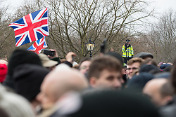 "© Licensed to London News Pictures . 18/03/2018 . London , UK . A policeman videos the crowd at Speakers Corner . 1000s including supports of alt-right groups such as Generation Identity and the Football Lads Alliance , at Speakers' Corner in Hyde Park where Tommy Robinson reads a speech by Generation Identity campaigner Martin Sellner . Along with Brittany Pettibone , Sellner was due to deliver the speech last week but the pair were arrested and detained by police when they arrived in the UK , forcing them to cancel an appearance at a UKIP "" Young Independence "" youth event , which in turn was reportedly cancelled amid security concerns . Photo credit: Joel Goodman/LNP"