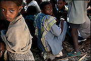"Childs and boys at the celebration of an early marriage. In Ethiopia survives the practice of forced child marriage, even though is forbidden by the law, quite often ignored. North West of Ethiopia, on friday, Febrary 13 2009.....In a tangled mingling of tradition and culture, in the normal place of living, in a laid-back attitude. The background of Ethiopia's ""child brides"", a country which has the distinction of having highest percentage in the practice of early marriages despite having a law that establishes 18 years as minimum age to get married. Celebrations that last days, their minds clouded by girls cups of tella and the unknown for the future. White bridal veil frame their faces expressive of small defenseless creatures, who at the age ranging from three to twelve years shall be given to young brides men adults already...To protect the identities of the recorded subjects names and specific places are fictional."