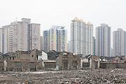 Vanishing Shanghai I. An area of Hutongs or traditional low-rise housing sits between already demolished housing and new high rise developments behind.