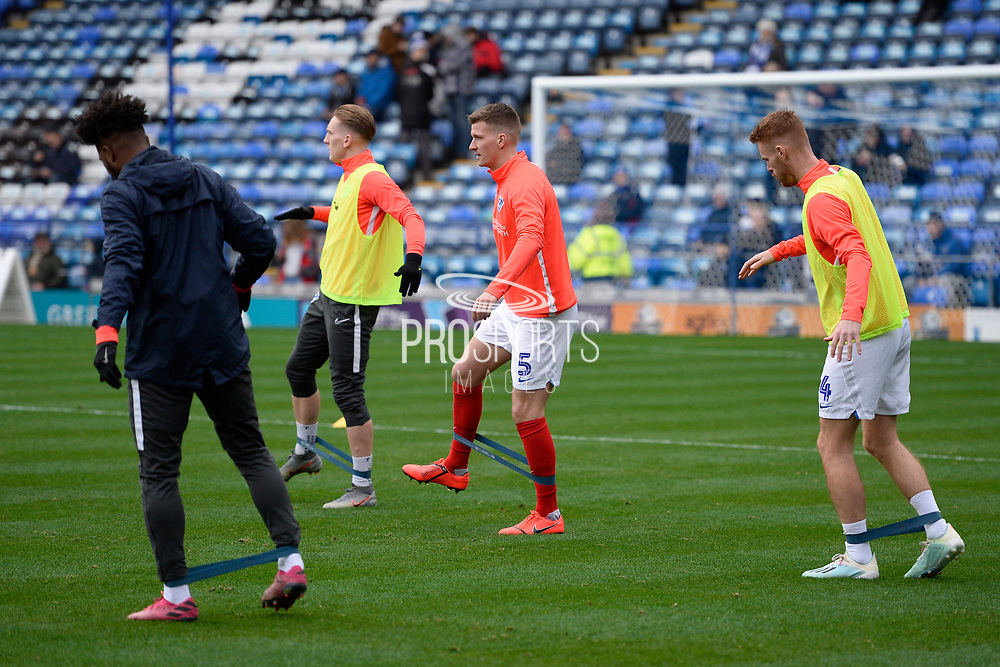 Paul Downing (5) of Portsmouth  warming up ahead of the EFL Sky Bet League 1 match between Portsmouth and Ipswich Town at Fratton Park, Portsmouth, England on 21 December 2019.