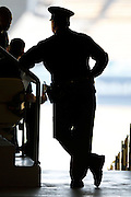 LOS ANGELES, CA - MAY 27:  A police officer in silhouette looks on during the Los Angeles Dodgers game against the Houston Astros on Sunday, May 27, 2012 at Dodger Stadium in Los Angeles, California. The Dodgers won the game 5-1. (Photo by Paul Spinelli/MLB Photos via Getty Images)