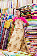 Showing off wedding dress fabric at Scott's Market, Yangon, Myanmar.