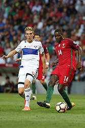 August 31, 2017 - Porto, Portugal - Portugal's midfielder William Carvalho vies with Faroe Islands' forward Joan Edmundsson during the 2018 FIFA World Cup qualifying football match between Portugal and Faroe Islands at the Bessa XXI stadium in Porto, Portugal on August 31, 2017. (Credit Image: © Pedro Fiuza/NurPhoto via ZUMA Press)