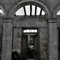 An old archway to a derelict house