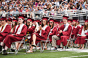 Arlington High School students listen to speeches during the graduation exercises for the Class of 2017 at the Warren A. Peirce Field in Arlington, June 3, 2017.   [Wicked Local Photo/James Jesson].