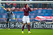 Sean Clare (#8) of Heart of Midlothian FC pulls his jersey over his face as he leaves the pitch, after receiving a red card during the Ladbrokes Scottish Premiership match between Heart of Midlothian FC and Aberdeen FC at Tynecastle Stadium, Edinburgh, Scotland on 29 December 2019.