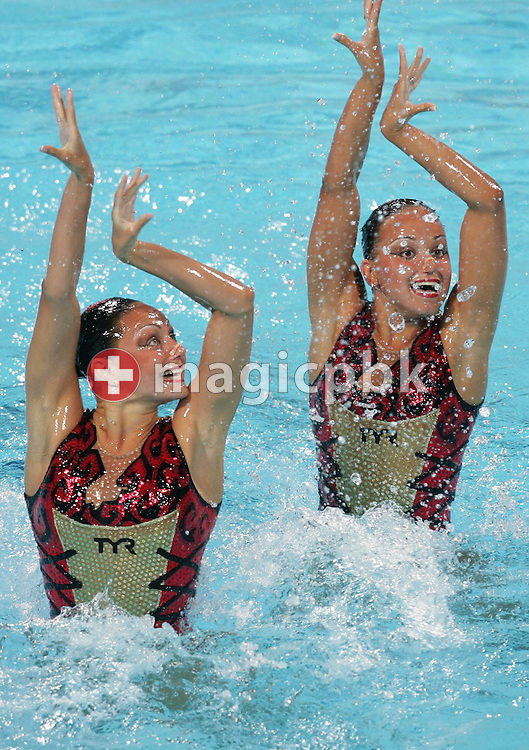 Russian swimmers Anastasia Davydova and Anastasia Ermakova perform their routine in the Synchronised women's Synchronised Swimming Free Routine of the Athens 2004 Olympic Games at the Olympic Aquatic Centre in Athens Tuesday 24 August 2004. The Russian couple takes the lead in the competition   ........ (Photo by Patrick B. Kraemer / MAGICPBK)