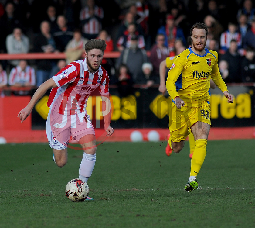 Cheltenham Town's Wes Burns wins the ball against Exeter City's Ryan Harley - Photo mandatory by-line: Nizaam Jones - Mobile: 07966 386802 - 21/03/2015 - SPORT - Football - Cheltenham - Whaddon Road - Cheltenham Town v Exeter City - Sky Bet League Two