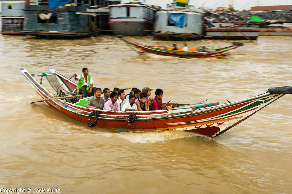 18 JUNE 2013 - YANGON, MYANMAR:   River taxis cross the Yangon River in Yangon. Many working class Burmese live on the far side of the river and the boats to commute to and from work every day.    PHOTO BY JACK KURTZ