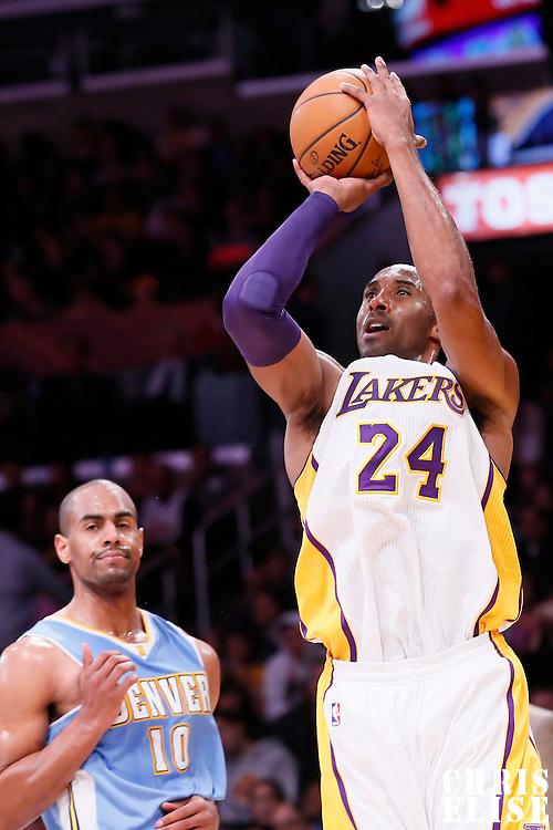 23 November 2014: Los Angeles Lakers guard Kobe Bryant (24) takes a jump shot during the Denver Nuggets 101-94 overtime victory over the Los Angeles Lakers, at the Staples Center, Los Angeles, California, USA.
