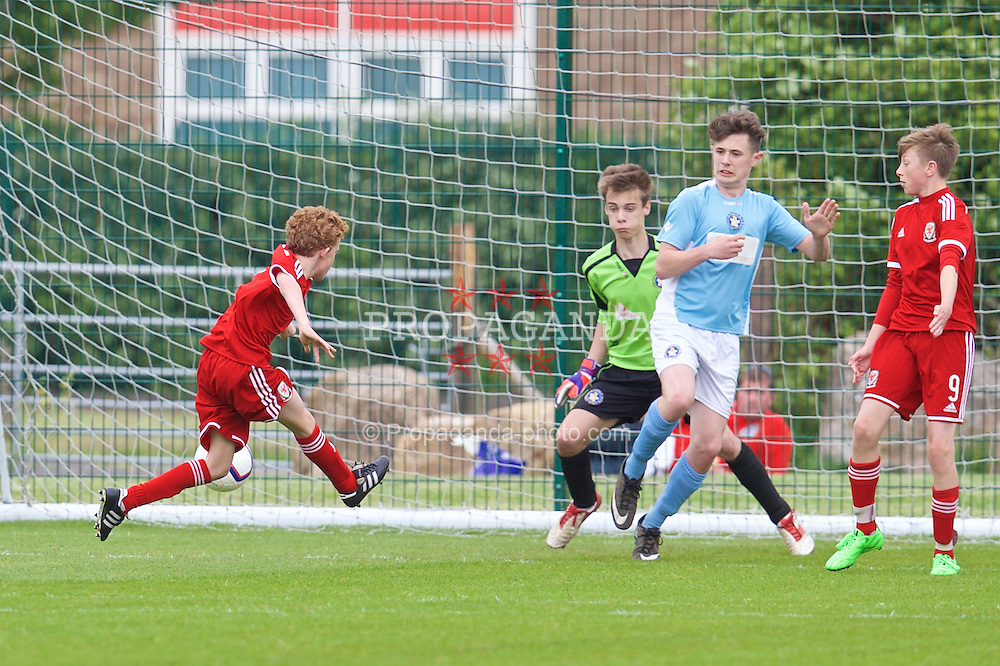 NEWPORT, WALES - Wednesday, May 27, 2015: Regional Development Boys' Lewis Clutton scores the second goal against South WPL Academy Boys during the Welsh Football Trust Cymru Cup 2015 at Dragon Park. (Pic by David Rawcliffe/Propaganda)