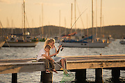 Children playing on Valentine Jetty, Lake Macquarie, NSW, Australia