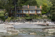 Building at the Galiano Inn on Galiano Island.  Photographed from the BC Ferry Salish Eagle in Sturdies Bay at Galiano Island, British Columbia, Canada.