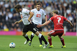Chris Martin of Derby County is fouled by Grant Leadbitter of Middlesbrough - Mandatory byline: Dougie Allward/JMP - 07966386802 - 18/08/2015 - FOOTBALL - iPro Stadium -Derby,England - Derby County v Middlesbrough - Sky Bet Championship