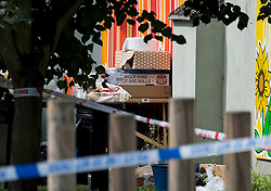 © Licensed to London News Pictures. 12/07/2020. London, UK. A police cordon around a Childs play area, which had been used for a BBQ, at the scene of a murder on the Black Prince Estate in Kennington South London, just a few hundred years from the House of Parliament. A man, believed to be in his 30s, was stabbed to death late last night . Photo credit: Ben Cawthra/LNP