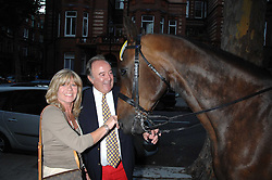 SIR DAI LLEWELLYN and INGRID SEWARD at a party to celebrate the 21st birthday of one of their horses Leopold, held at 35 Sloane Gardens, London W1 on 10th September 2007.<br />