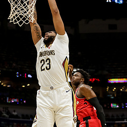 Oct 11, 2018; New Orleans, LA, USA; New Orleans Pelicans forward Anthony Davis (23) dunks over Toronto Raptors forward OG Anunoby (3) during the first half at the Smoothie King Center. Mandatory Credit: Derick E. Hingle-USA TODAY Sports