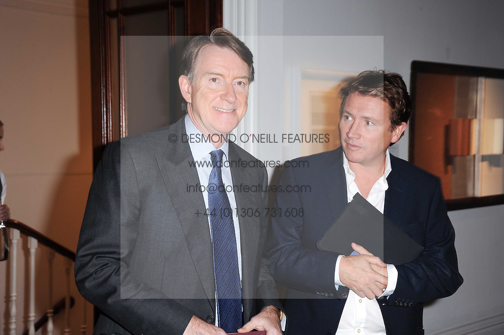 Left to right, LORD MANDELSON and JOHNNY HORNBY at the Krug Mindshare auction held at Sotheby's, New Bond Street, London on 1st November 2010.