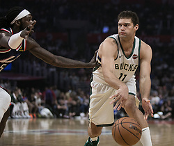 November 10, 2018 - Los Angeles, California, U.S - Brook Lopez #11 of the Milwaukee Bucks is passes the ball past Montrezl Harrell #5 of the Los Angeles Clippers during their NBA game on Saturday November 10, 2018 at the Staples Center in Los Angeles, California. Clippers defeat Bucks in OT, 128-126. (Credit Image: © Prensa Internacional via ZUMA Wire)