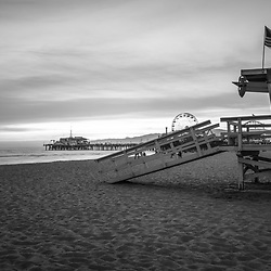 Santa Monica Pier and Lifeguard Tower 17 black and white photo along the Pacific Ocean in Southern California. Copyright ⓒ 2017 Paul Velgos with All Rights Reserved.