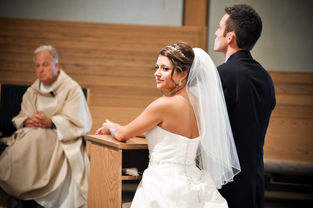 Michelle takes in her wedding ceremony at Holy Spirit Catholic Community Church, Naperville, IL
