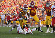 November 06 2010: Iowa State Cyclones running back Alexander Robinson (33) fumbles the ball as he is hit by Nebraska Cornhuskers safety Austin Cassidy (8) during the second half of the NCAA football game between the Nebraska Cornhuskers and the Iowa State Cyclones at Jack Trice Stadium in Ames, Iowa on Saturday November 6, 2010. Nebraska defeated Iowa State 31-30.