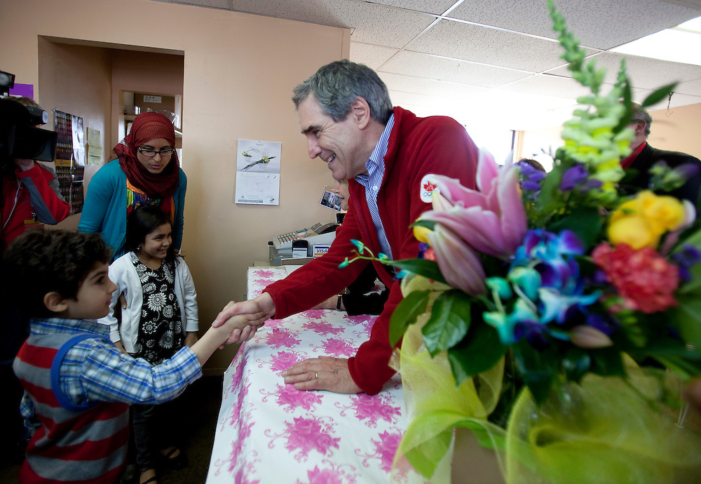Liberal leader Michael Ignatieff shakes hands with young liberal supporters during a campaign stop at Murree Flowers, in London, Ontario, Friday April 19, 2011.<br /> REUTERS/Geoff Robins (CANADA)