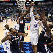 Marquel Curtis, (center), Tulsa, shoots while challenged by Daniel Hamilton and Terrence Samuel, (right), UConn, during the UConn Huskies Vs Tulsa Semi Final game at the American Athletic Conference Men's College Basketball Championships 2015 at the XL Center, Hartford, Connecticut, USA. 14th March 2015. Photo Tim Clayton