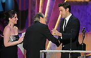 Steve Buscemi receives his award from Tina Fey and John Krasinski who presented Male Actor in a Drama Series. The 18th Annual Screen Actors Guild Awards were held at the Shrine Exposition Center in Los Angeles, CA 1/29/2012(John McCoy/Staff Photographer)