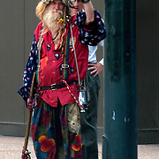 Protesters seemed to be everywhere in Denver.  They were protesting the war along Broadway by the state capitol.  This fellow walked north on California Street, stopping at the light at 18th Street.  I shot a few images of him because he was a colorful character flashing the peace sign,  It wasn't until another man. with his hands on his hips, came up behind him, that the real picture happened.  The other man can be seen looking ay Peaceman with disdain and  disapproval on his face...Two people, two view points, the First Amendment in action.