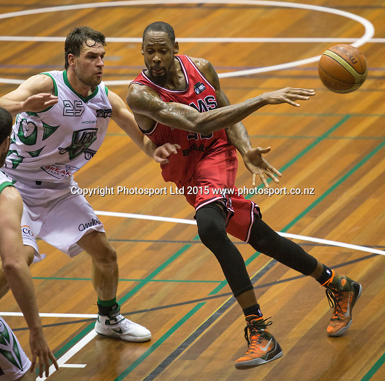 Mickell Gladness of the Rams with Jeremiah Trueman of the Jets in defence during the National Basketball League game between the Canterbury Rams v Manawatu Jets at Cowles Stadium in Christchurch. 10th April 2015 Photo: Joseph Johnson/www.photosport.co.nz