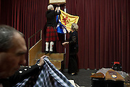 Organisers removing Scottish flags from the hall at the end of a St. Andrew's dinner dance held by the Sandbach and District Caledonian Society at Sandbach Town Hall, Cheshire, England on St. Andrew's Day. Around 40 people from the Society attended the meal and dance which included a programme of Scottish country dancing. St. Andrew was the patron saint of Scotland and the day was celebrated by Scots worldwide on the 30th November.