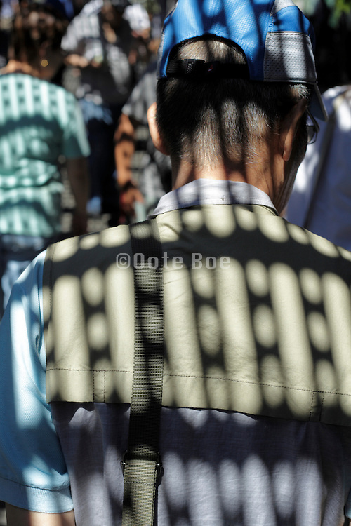 senior man with sunlight pattern overlay
