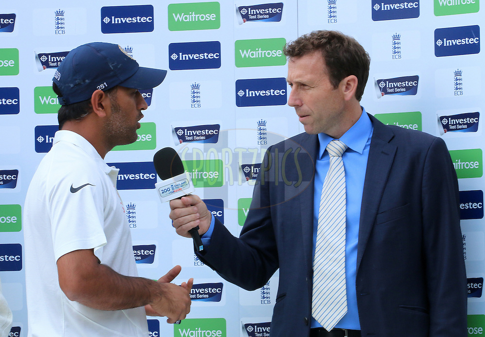 Mahendra Singh Dhoni captain of India interviewed after the match  during day three of the fifth Investec Test Match between England and India held at The Kia Oval cricket ground in London, England on the 17th August 2014<br /> <br /> Photo by Ron Gaunt / SPORTZPICS/ BCCI
